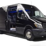 Black luxury Mercedes Benz Sprinter Limousine with sliding door open to interior
